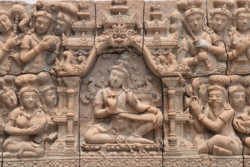 Low relief cement Thai style handcraft of hindu gods on wall