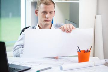Architect finishing his work