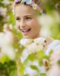 Rose garden - beautiful girl playing in the rose garden