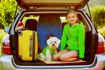 Travel - girl with dog ready for the travel for vacation