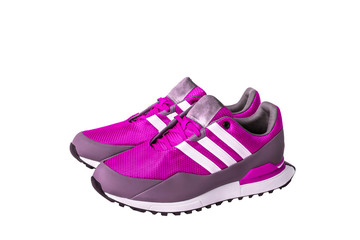 pink sport shoes for running on white background