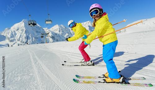 Fototapeta Skiing, winter, ski lesson - skiers on mountainside