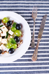 tasty salad with grape and cheese, close up