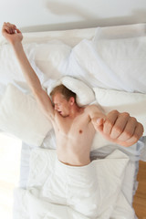 Yawning man in bed