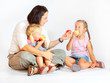 Young family eating fresh ripe apples.