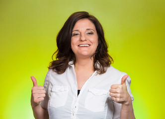Smiling happy businesswoman with thumbs up gesture