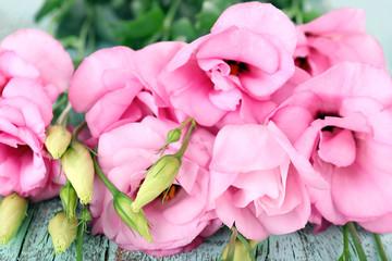 Beautiful eustoma flowers on wooden background