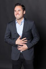 Geschaeftsmann mit Bauchschmerzen