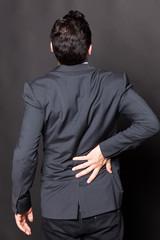 Geschäftsmann mit Rückenproblemen