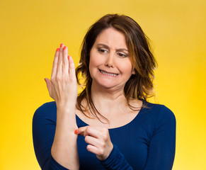 Woman pinches her skin Reality check hand gesture