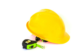 safety helmet and tape measure on white background