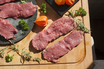 Sirloin on a cutting board, and a stoneplate