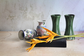 Vintage still life vases and a book