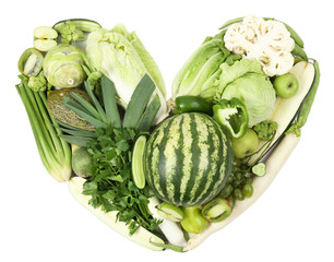 Fresh organic vegetables in shape of heart, close up
