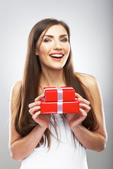 Beauty smiling woman hold gift.