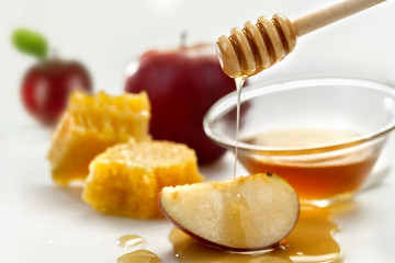 Honey dripping on a apple on the white background