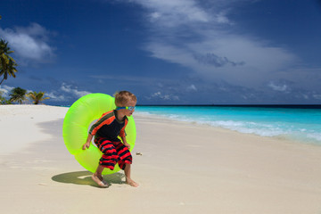 little boy playing at tropical beach