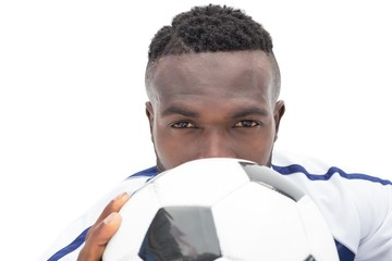 Close up portrait of a serious football player