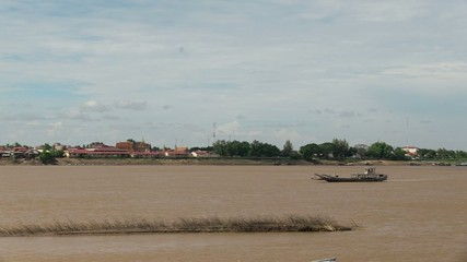 Old wood boat crossing the mekong river (3)