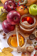 Honey, apples and autumn fruits on the white background