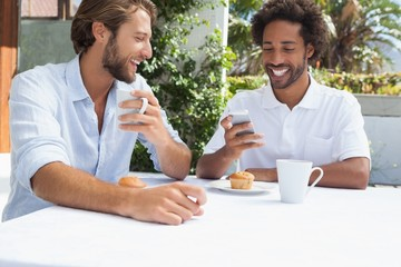 Two friends enjoying coffee together