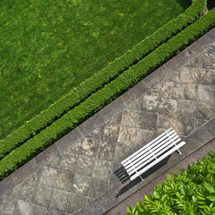 Geometric background with a white bench in a park. Top vie