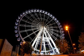 Working big wheel at night in Zaragoza, Spain
