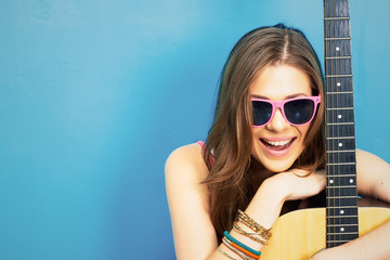 close up face portrait of young woman with guitar