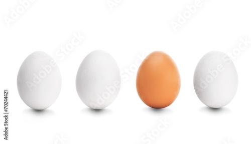 Leinwanddruck Bild Four chicken egg on white background