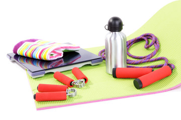 Sport requisites on a carpet isolated on white
