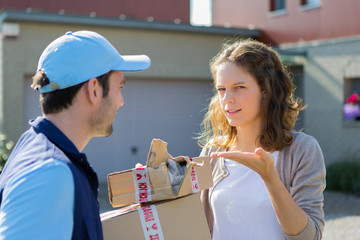 Young attractive woman angry against delivery man