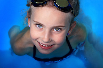 Young girl in the swimming pool
