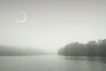 eclipse of the sun in the autumn mist.