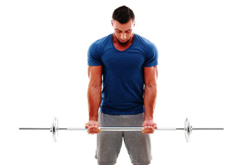 Muscular man doing exercises with barbell over white background