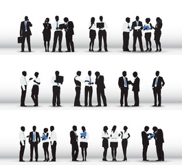 Silhouettes of Business People Working in a Row