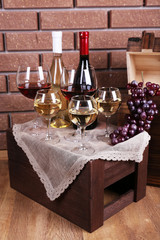 Bottles and glasses of wine and ripe grapes