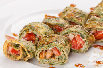 Sliced ​​zucchini pancakes, stuffed with vegetables and red