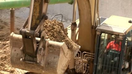Bulldozer Filling Dump Truck