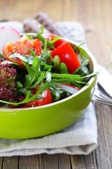 fresh salad with arugula, radish and tomatoes