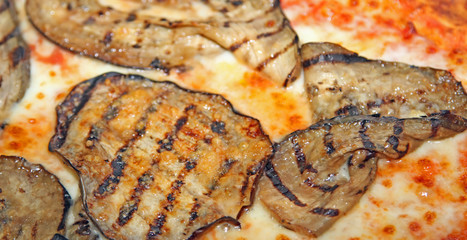 Pizza cooked on a wood-burning oven with grill Eggplant