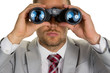 Leinwandbild Motiv Manager mit Fernglas