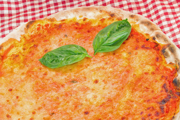 Pizza with tomato and mozzarella with fresh basil leaves