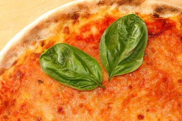 tasty Pizza with tomato and mozzarella with basil