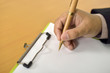Man Writing On Blank Paper