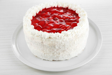 White cake on bright background close-up
