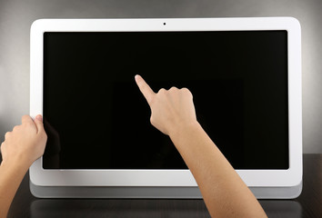 Modern tablet pc on grey background