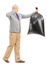 Senior carrying a stinky garbage bag