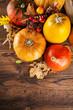 Autumn pumpkins on wooden planks