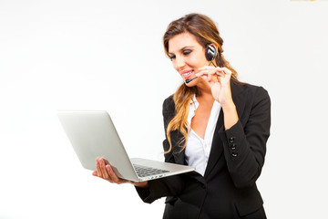 Woman in a call center holding a laptop