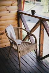 wicker chair on a cosy balcony